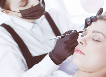 Microblading eyebrows work flow in a beauty salon.