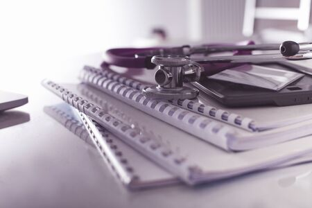 Medical record concept with stethoscope over pile of document Stock Photo