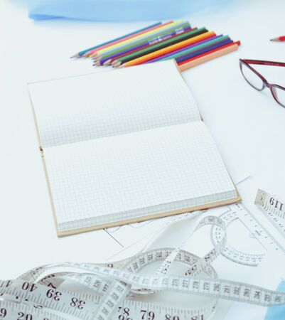 Designer table with blank note and tools Stock Photo - 128831508