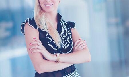 A beautiful blond business woman open the office door .