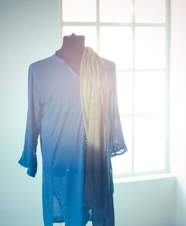 Mannequin with blue cloth in room, on grey background Stock Photo - 128831523
