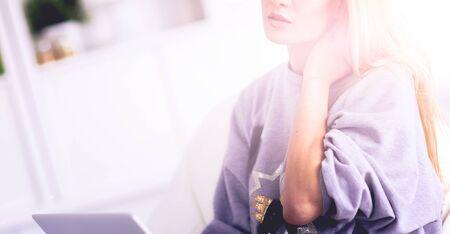 Young beautiful woman using a laptop computer at home 版權商用圖片