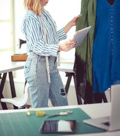 Fashion designer working on her designs in the studio Stock fotó