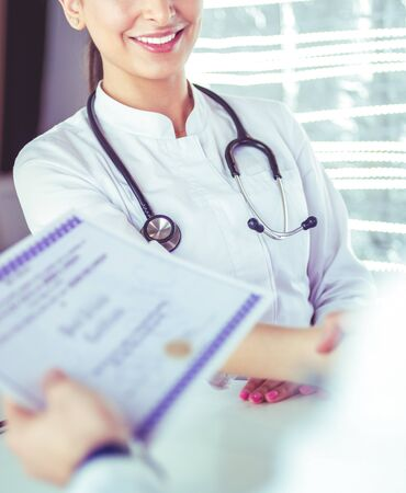Young woman medical people handshaking at office
