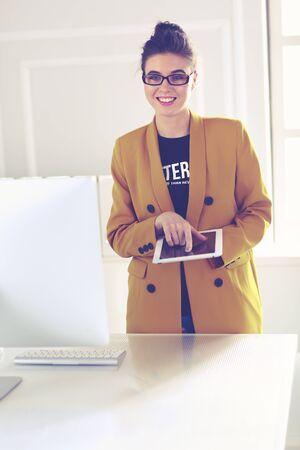 Portrait of a beautiful business woman standing near her workplace Zdjęcie Seryjne