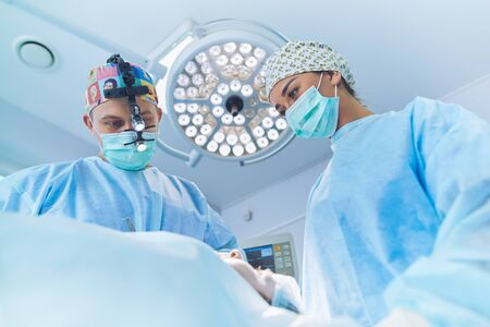 Man surgeon at work in operating room