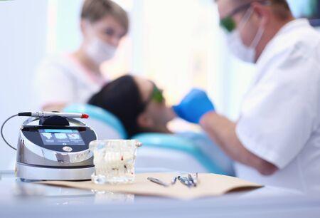 Dental equipment tools dentist medicine on desk. Stockfoto