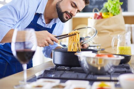 Man preparing delicious and healthy food in the home kitchen Stock fotó