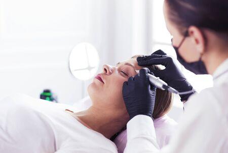 Microblading eyebrows work flow in a beauty salon Reklamní fotografie