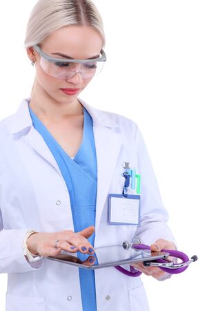 Female doctor using a digital tablet and standing on white background. Woman doctors.