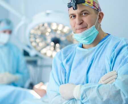 Male surgeon on background in operation room Stockfoto