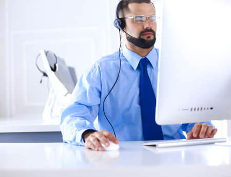 Businessman in the office on the phone with headset