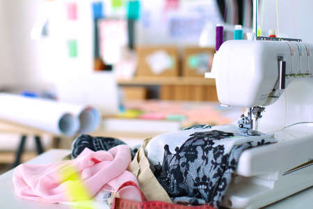 Sewing mashine,fabric and material for sewing Imagens