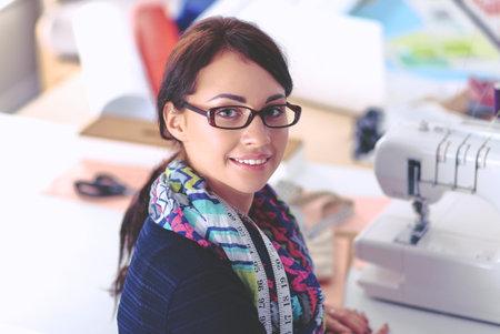 Beautiful fashion designer standing in studio Stock Photo