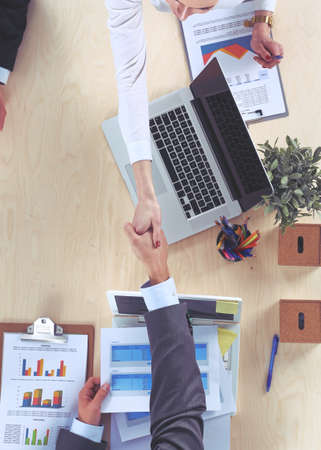 Business people handshake, sitting at the table Stock Photo