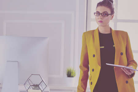 Portrait of a beautiful business woman standing near her workplace Stock Photo