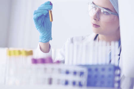 laboratory assistant woman analyzing a blood sample