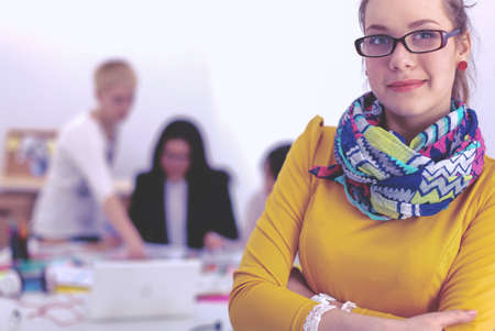 Portrait of a young woman working at office Stock Photo