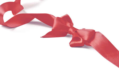 Red satin gift bow isolated on white background