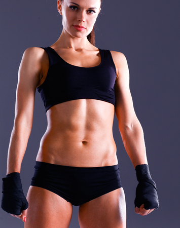 showing muscles: Athletic woman showing muscles