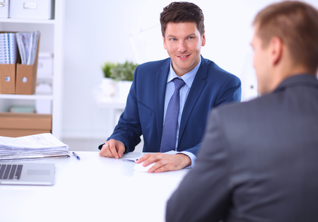 Business people working with laptop in an office, sitting ta the desk Standard-Bild
