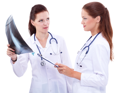 x ray image: Two woman doctor watching X Ray image