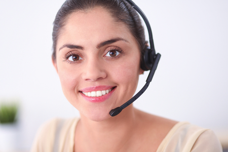 call center people in isolated: portrait of a customer service agent sitting at office Stock Photo