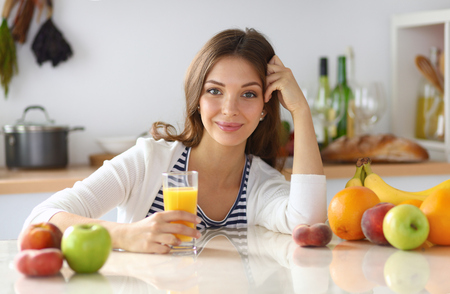 fruit juices: Portrait of a pretty woman holding glass with tasty juice