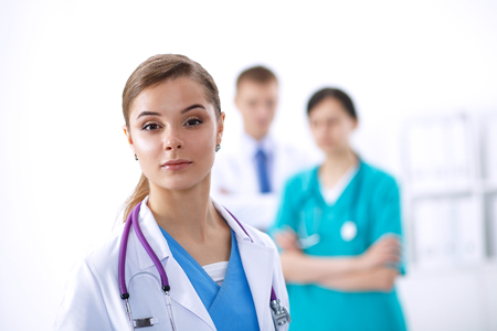 attractive  female: Attractive female doctor in front of medical group .