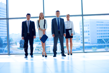 manager team: Young business people go down of modern office .