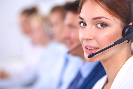 on call: Attractive  positive young businesspeople and colleagues in a call center office Stock Photo