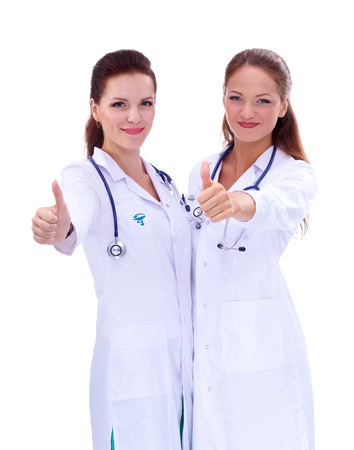 medical decisions: Two young woman doctor showing ok , standing in hospital, isolated