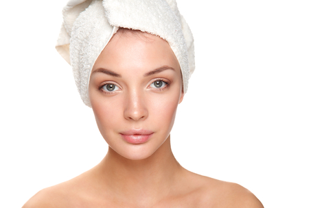 towel head: Beautiful woman with a towel on his head on a white background