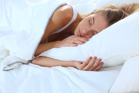 1 woman only: Beautiful girl sleeps in the bedroom .