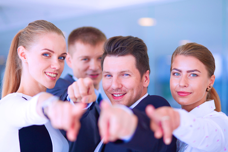 team business: Group of business people pointing to you .