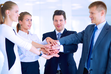 conference meeting: Business people with their hands together in a circle .