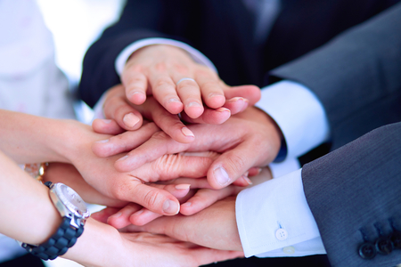 meeting together: Business people with their hands together in a circle .