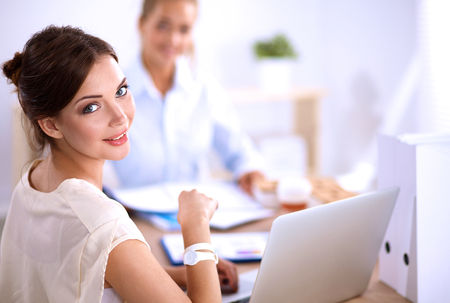 thoughtful woman: Portrait of a businesswoman sitting at a desk with a laptop. Stock Photo