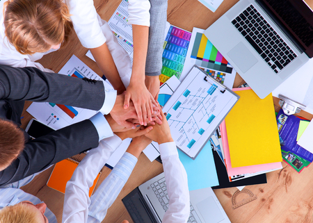 team hands: Business team with hands together - teamwork concepts. Stock Photo