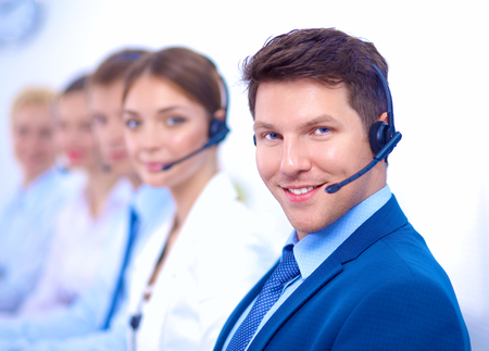 business services: Attractive  positive young businesspeople and colleagues in a call center office Stock Photo
