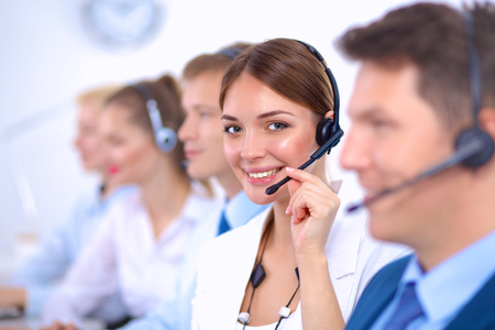 Attractive  positive young businesspeople and colleagues in a call center office Фото со стока