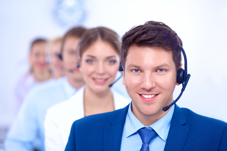 Attractive  positive young businesspeople and colleagues in a call center office Standard-Bild