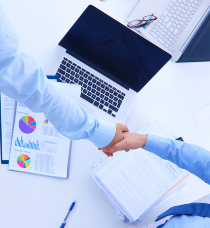 altogether: Business people shaking hands, finishing up a meeting, in office. Stock Photo