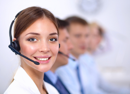 help center: Attractive  positive young businesspeople and colleagues in a call center office Stock Photo