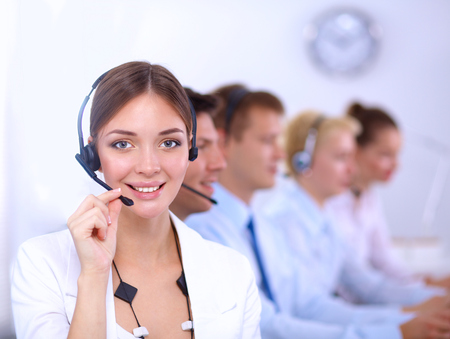 contact center: Attractive  positive young businesspeople and colleagues in a call center office Stock Photo
