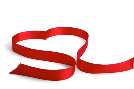 shaping: A red ribbon shaping heart , isolated on white background Stock Photo
