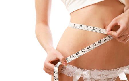 underclothing: A woman measuring her waist