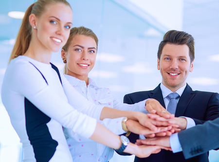 high: Business people with their hands together in a circle