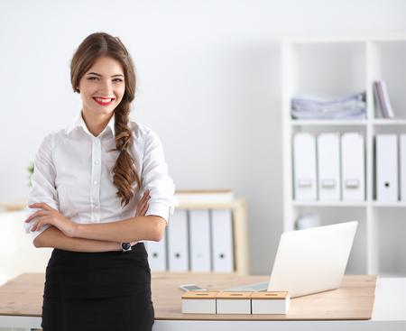 businesswoman standing: Attractive businesswoman standing Stock Photo