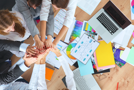 entrepreneur: Business team with hands together - teamwork concepts. Stock Photo